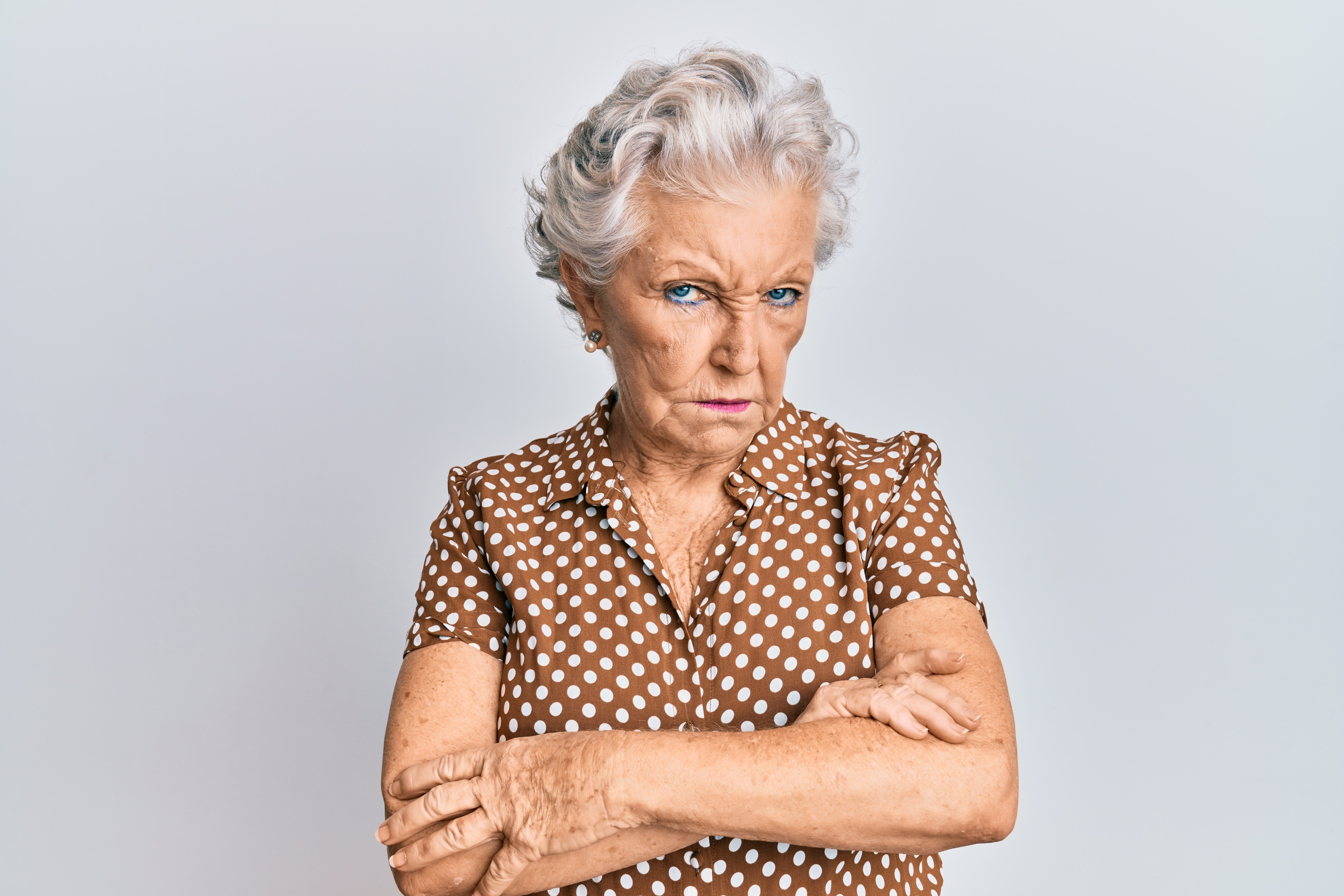 An elderly woman with a disapproving stare.   Source: Shutterstock