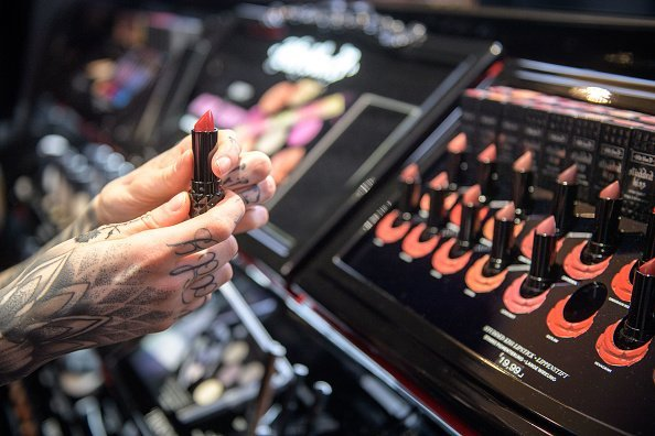 A collection of various types of colors of lipsticks at a make-up and cosmetic products shop | Photo: Getty Images