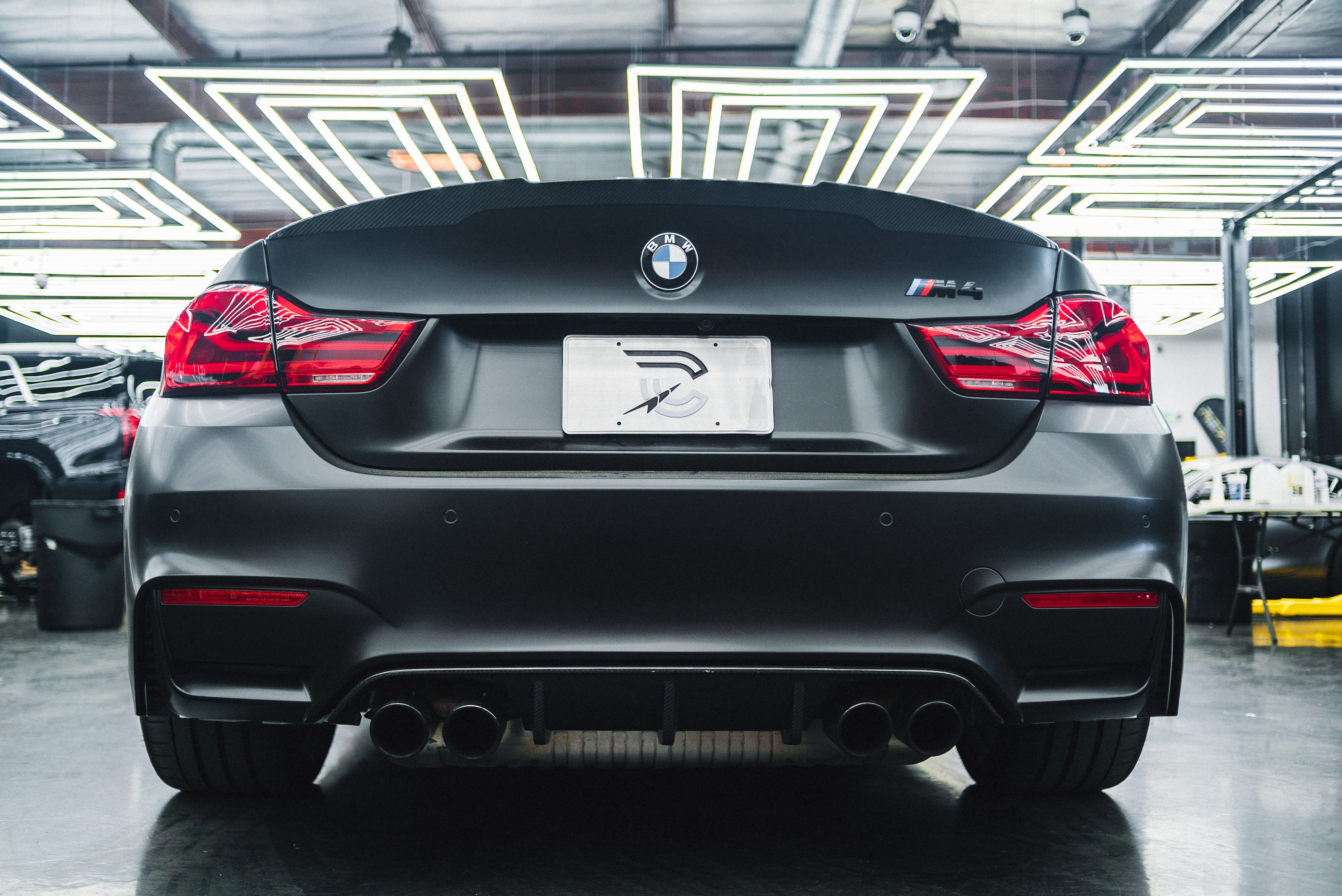 Pictured - A black BMW M4 coupe   Source: Pexels