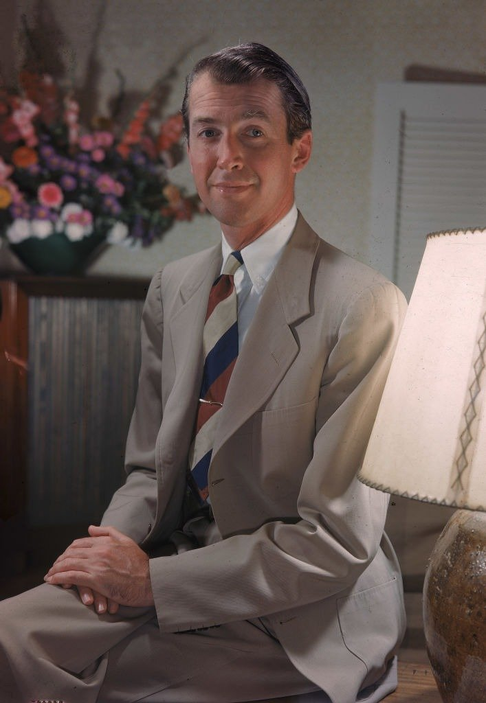 Portrait of American actor Jimmy Stewart (1908 -1997) seated wearing a tan suit, 1940s.   Photo: Getty Images