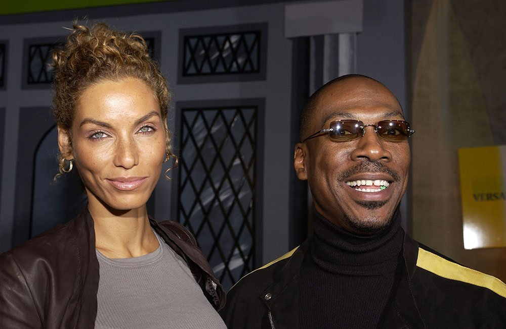 """Eddie Murphy and wife Nicole Mitchell during DreamWorks' celebration of the DVD release of """"Shrek 2"""" at Spago in Beverly Hills, California. I Image: Getty Images."""