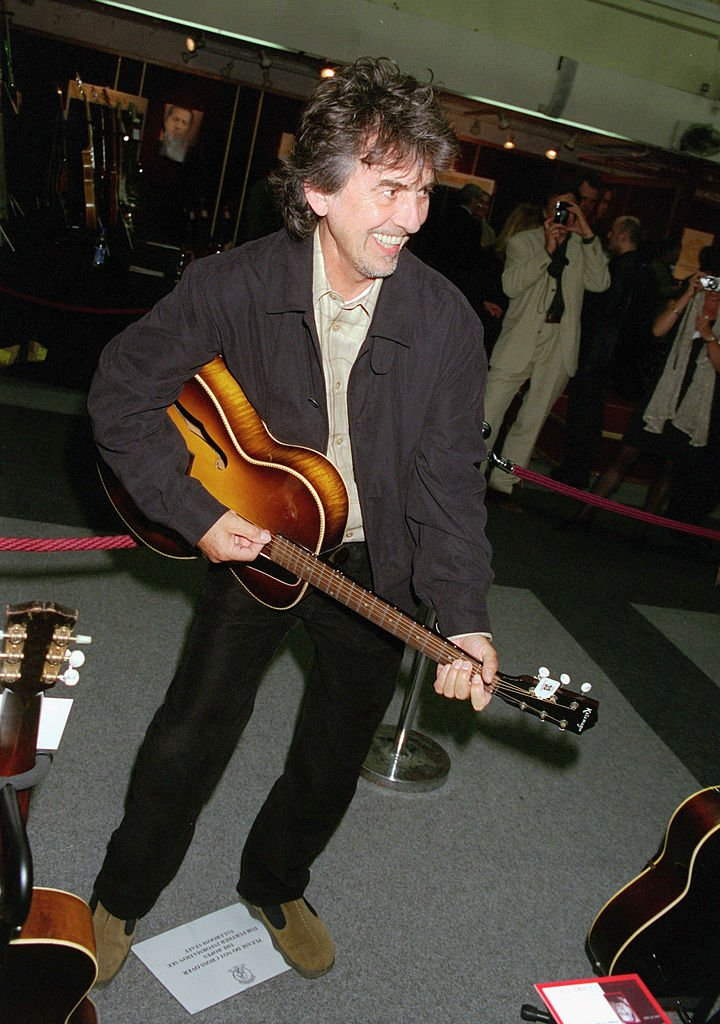 Musician George Harrison plays some of the guitars on offer at Christie's Auction on June 24 at Christie's | | Getty Images / Global Images Ukraine