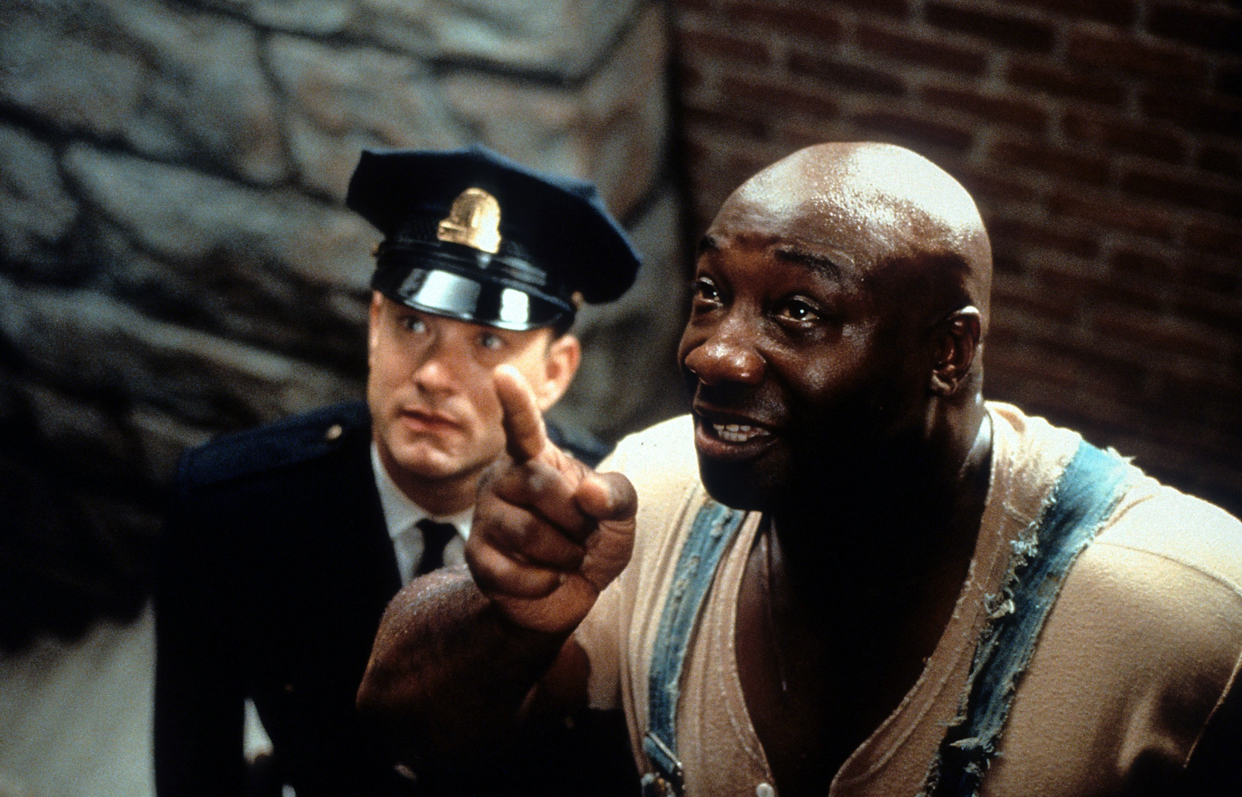 Tom Hanks is guided by Michael Clarke Duncan in a scene from the film 'The Green Mile', 1999 | Photo: Getty Images