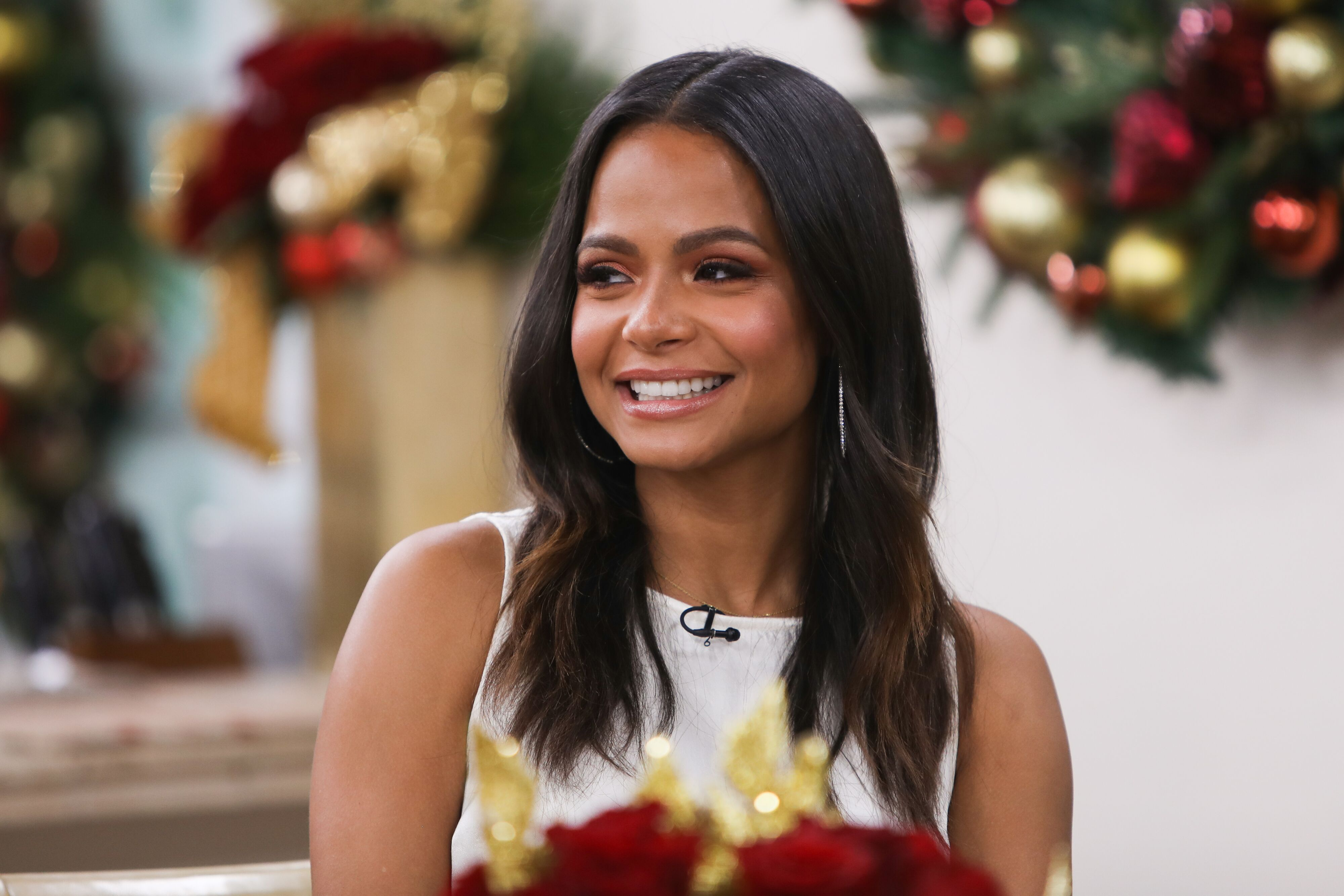 Christina Milian flashes a smile at a formal event | Source: Getty Images/GlobalImagesUkraine