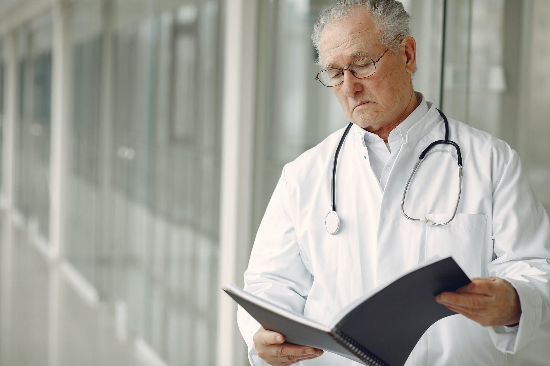Doctor looking at a folder | Source: Pexels