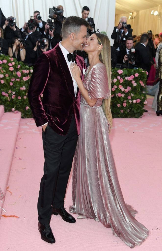 Tom Brady and Gisele Bundchen pose as they arrive for the 2019 Met Gala celebrating Camp: Notes on Fashion. | Source: Getty Images
