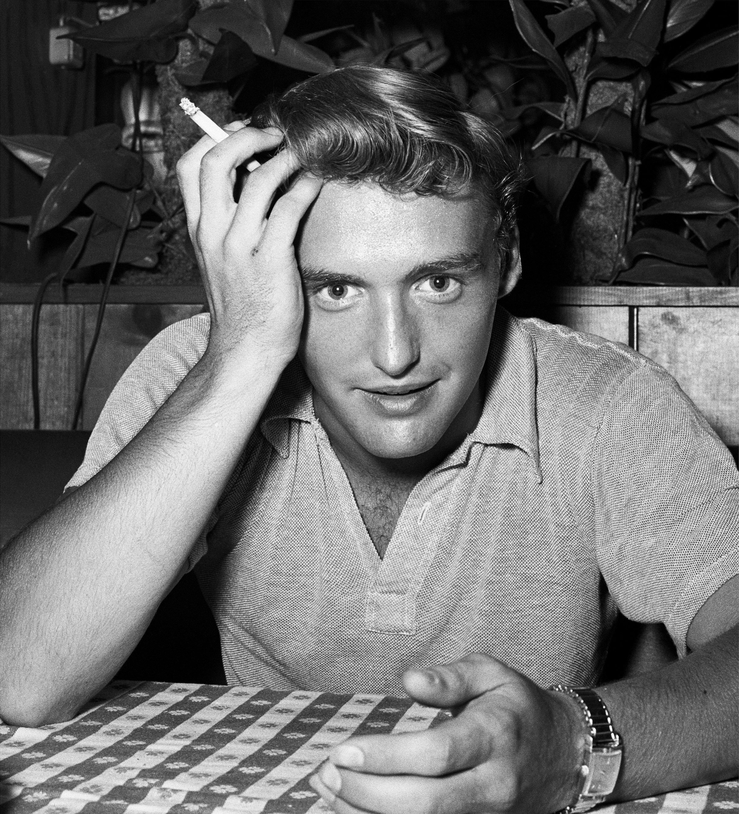 Dennis Hopper poses for a portrait at a restaurant in 1955. | Source: Getty Images