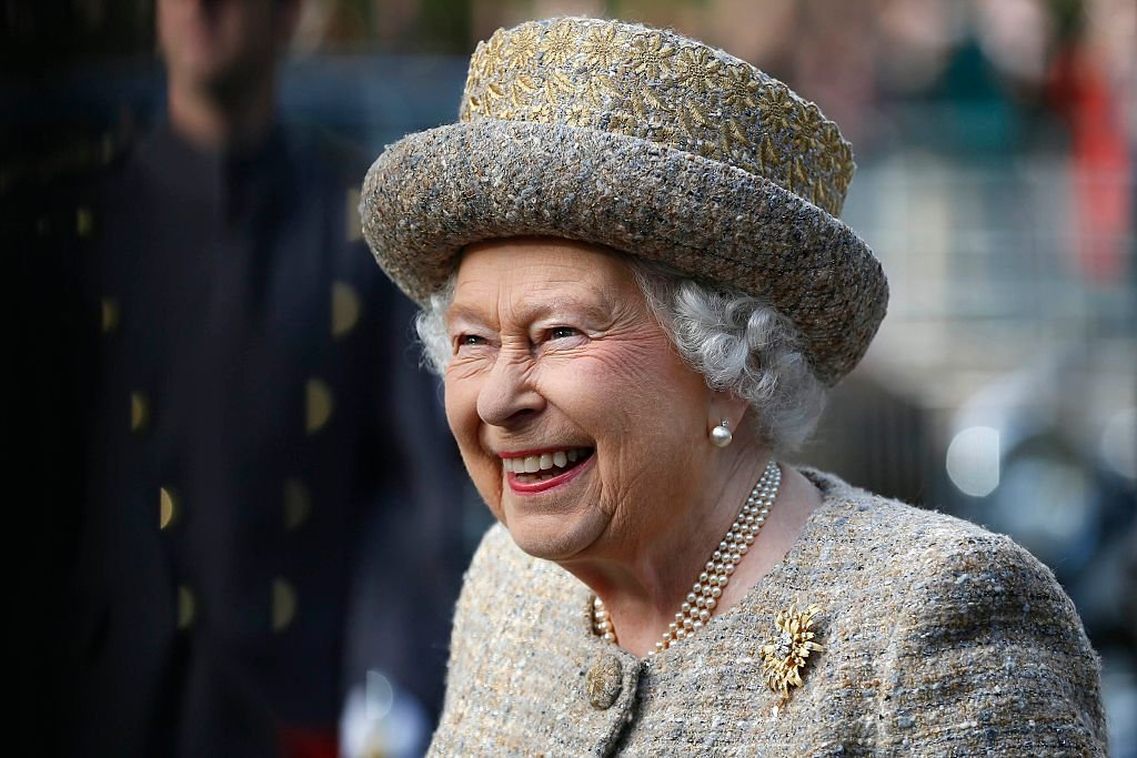 Queen Elizabeth II smiles as she arrives before the Opening of the Flanders' Fields Memorial Garden at Wellington Barracks on November 6, 2014 | Photo: Getty Images