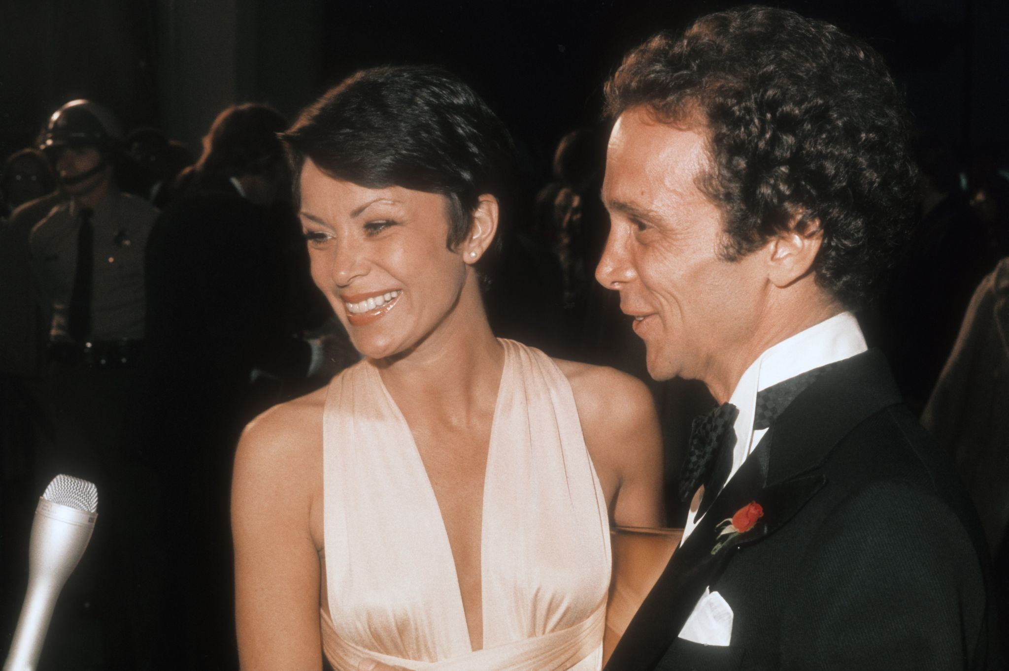 Joel Grey and wife Jo Wilder  at the 1975 Academy Awards in Los Angeles, California | Source: Getty Images