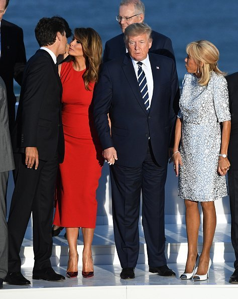 Canada's Prime Minister Justin Trudeau, US First Lady Melania Trump, US President Donald Trump, French President's wife Brigitte Macron about to pose together with other G7 leaders and guests at the annual G7 summit on August 25, 2019 in Biarritz, France | Photo: Getty Images