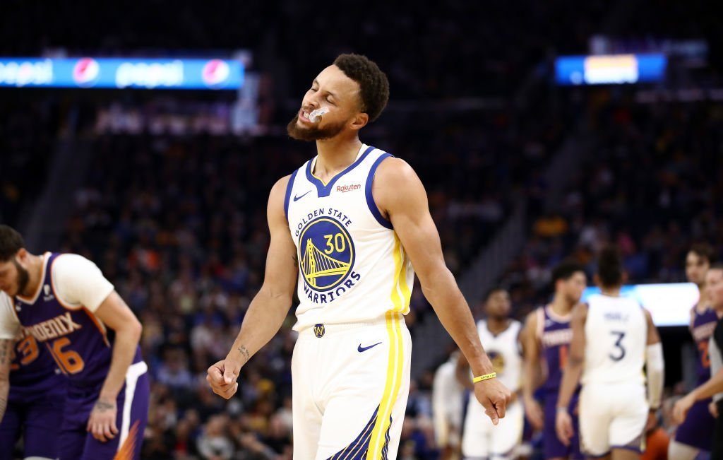 Stephen Curry #30 of the Golden State Warriors reacts during the first half of their game against the Phoenix Suns at Chase Center | Photo: Getty Images