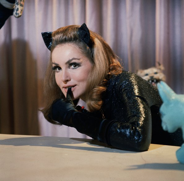 "Julie Newmar as CatWoman bites on her glove from a public photo of the TV Series ""BATMAN"" 