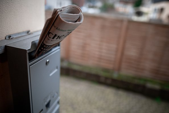 There's a newspaper stuck in a mailbox at one of the front doors | Photo: Getty Images