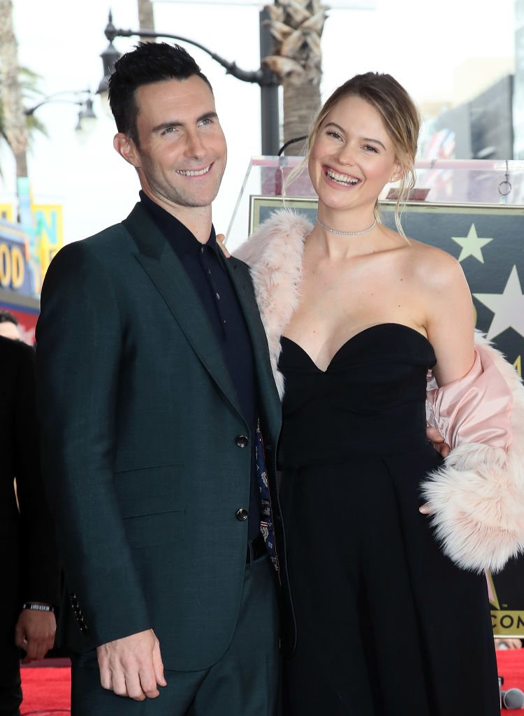 Adam Levine and Behati Prinsloo at the Hollywood Walk of Fame where he was honored with a Star  on February 10, 2017 in Hollywood, California | Photo: Getty Images