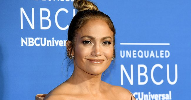 Jennifer Lopez Shows off a Deep Tan and Blonde Hair as She Poses in a Coach Trench Coat