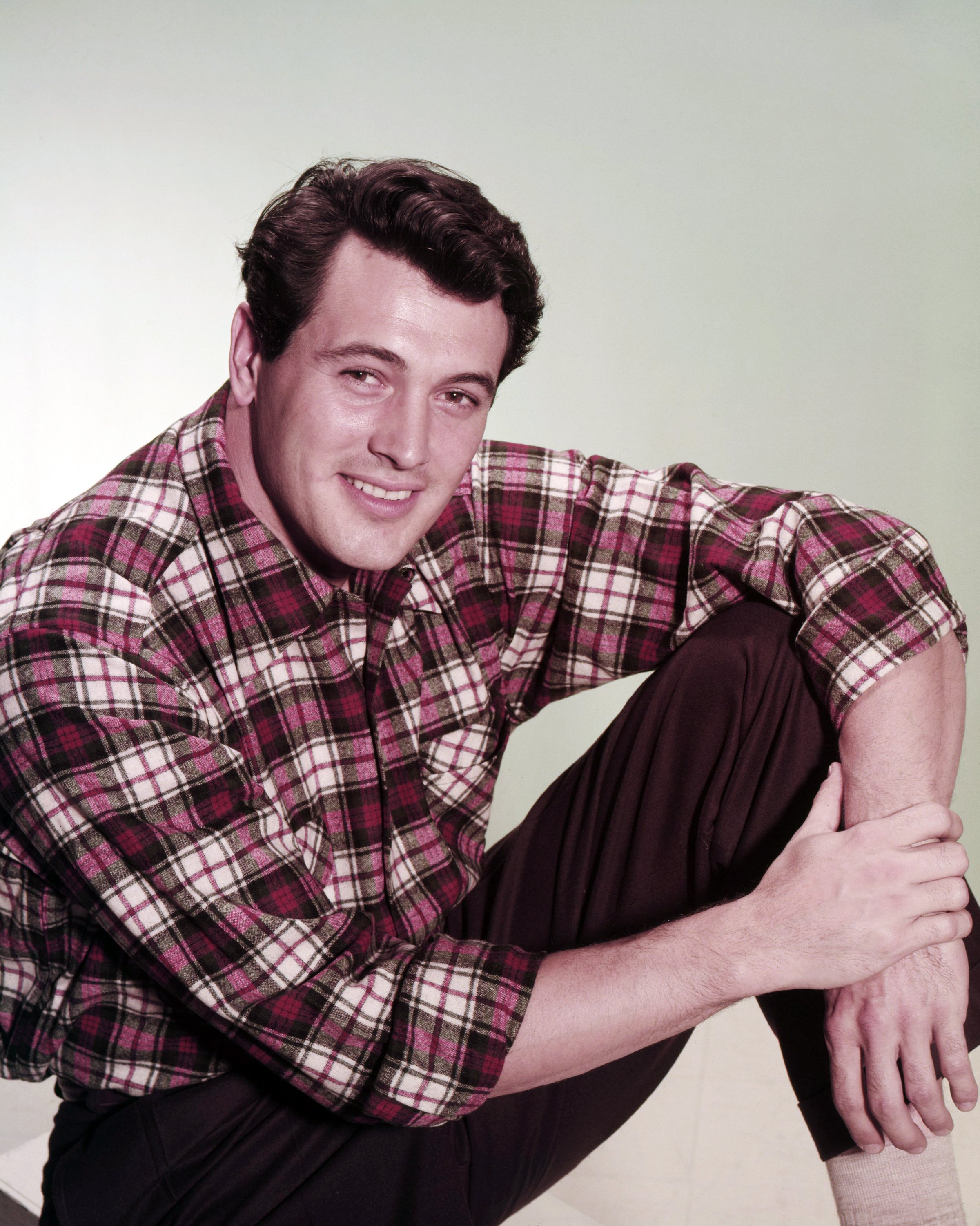 A portrait of American actor, Rock Hudson, wearing a plaid shirt, circa 1955 | Photo: Getty Images