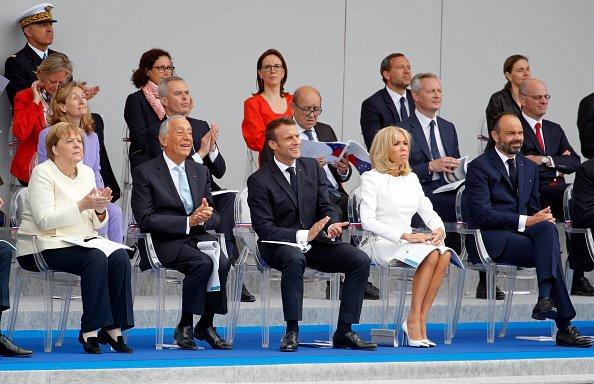 Emmanuel Macron et son épouse, Brigitte Macron participent au traditionnel défilé militaire du 14 juillet 2019 sur l'avenue Champs-Elysées à Paris | Photo : Getty Images