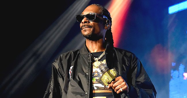 See Snoop Dogg's Granddaughter Lulu Learning How to Swim in These Cute Photos with Her Mom