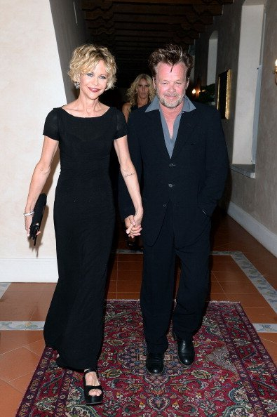 John Mellencamp and Meg Ryan at Teatro Antico on June 20, 2013 in Taormina, Italy | Photo: Getty Images