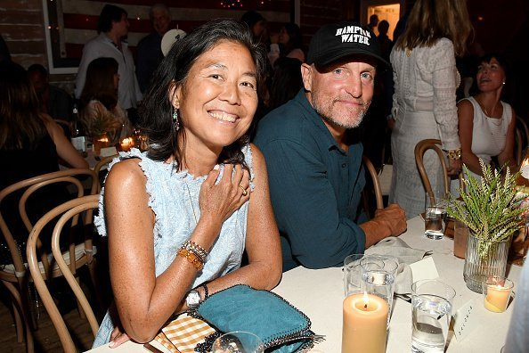 Laura Louie and Woody Harrelson attend Apollo in the Hamptons 2019 on August 03, 2019 | Photo: Getty Images