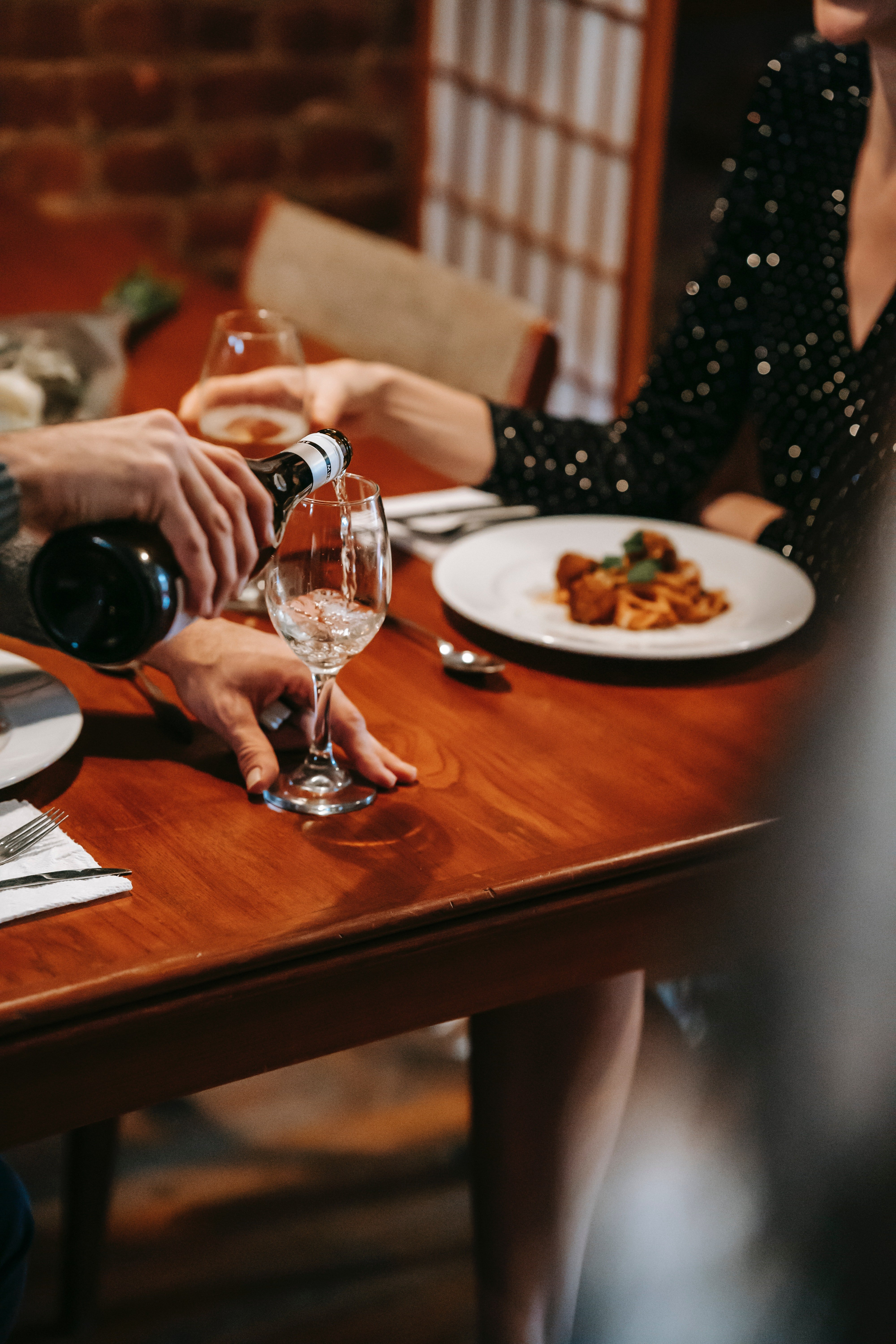 I was having dinner with Jonathan when he popped the question | Source: Pexels