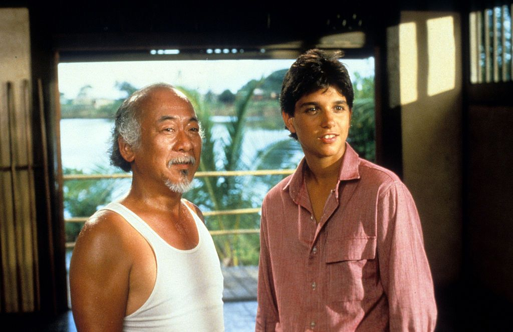 Pat Morita and Ralph Macchio during a scene from the film 'The Karate Kid', 1984. | Source: Getty Images