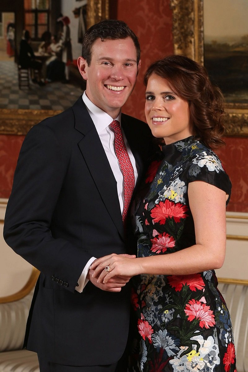 Princess Eugenie and Jack Brooksbank posing at the Picture Gallery at Buckingham Palace after they announced their engagement in London, England, in January 2018. | Photo: Getty Images.