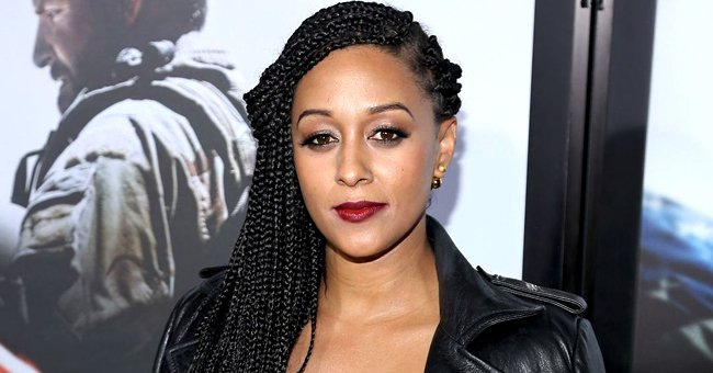 Tia Mowry Slays as She Shows off Her Fit Body in High-Waisted Blue Jeans & Puff Sleeve Blouse
