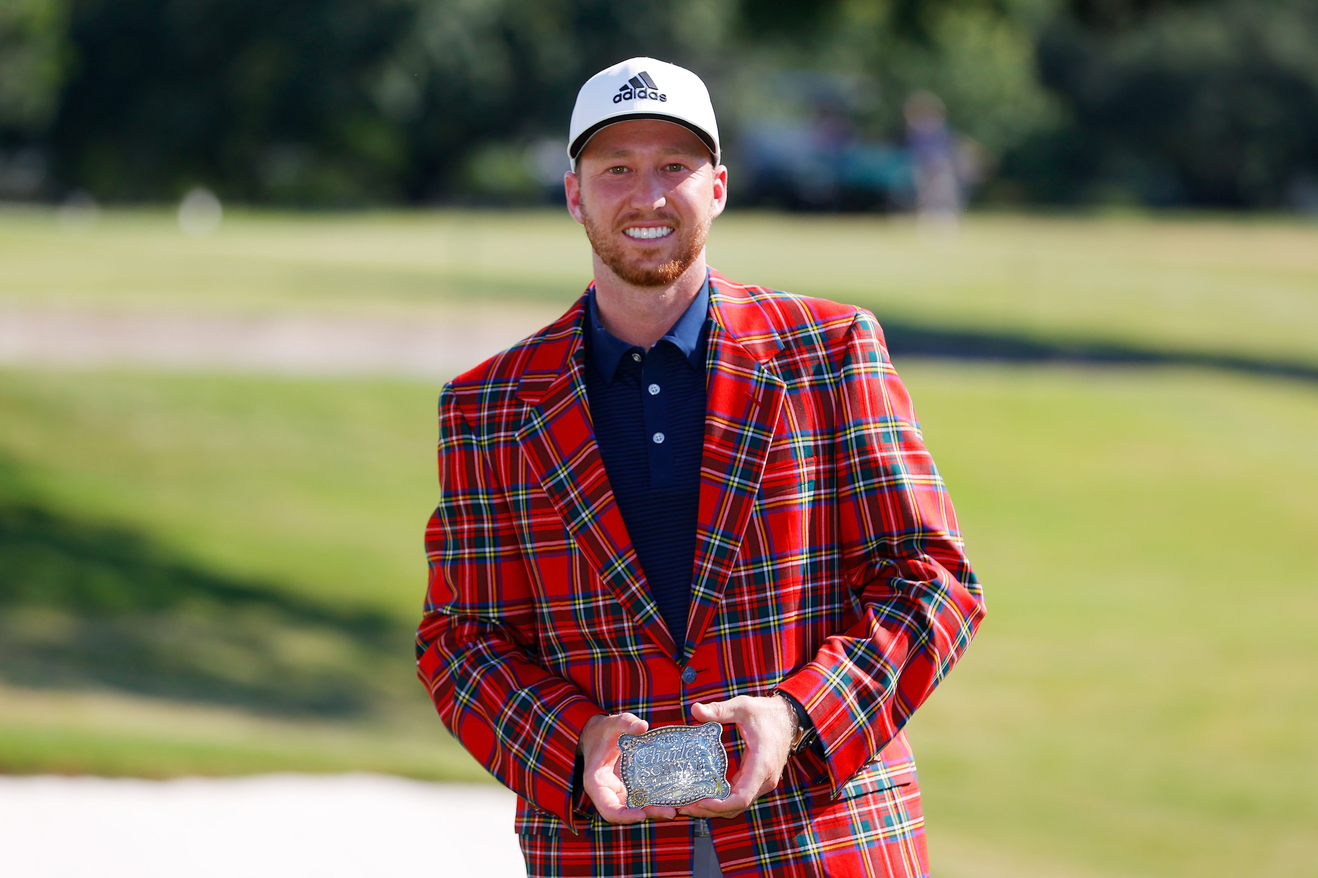 Daniel Berger with the plaid jacket and belt buckle after winning the Charles Schwab Challenge on June 14, 2020    Source: Getty Images