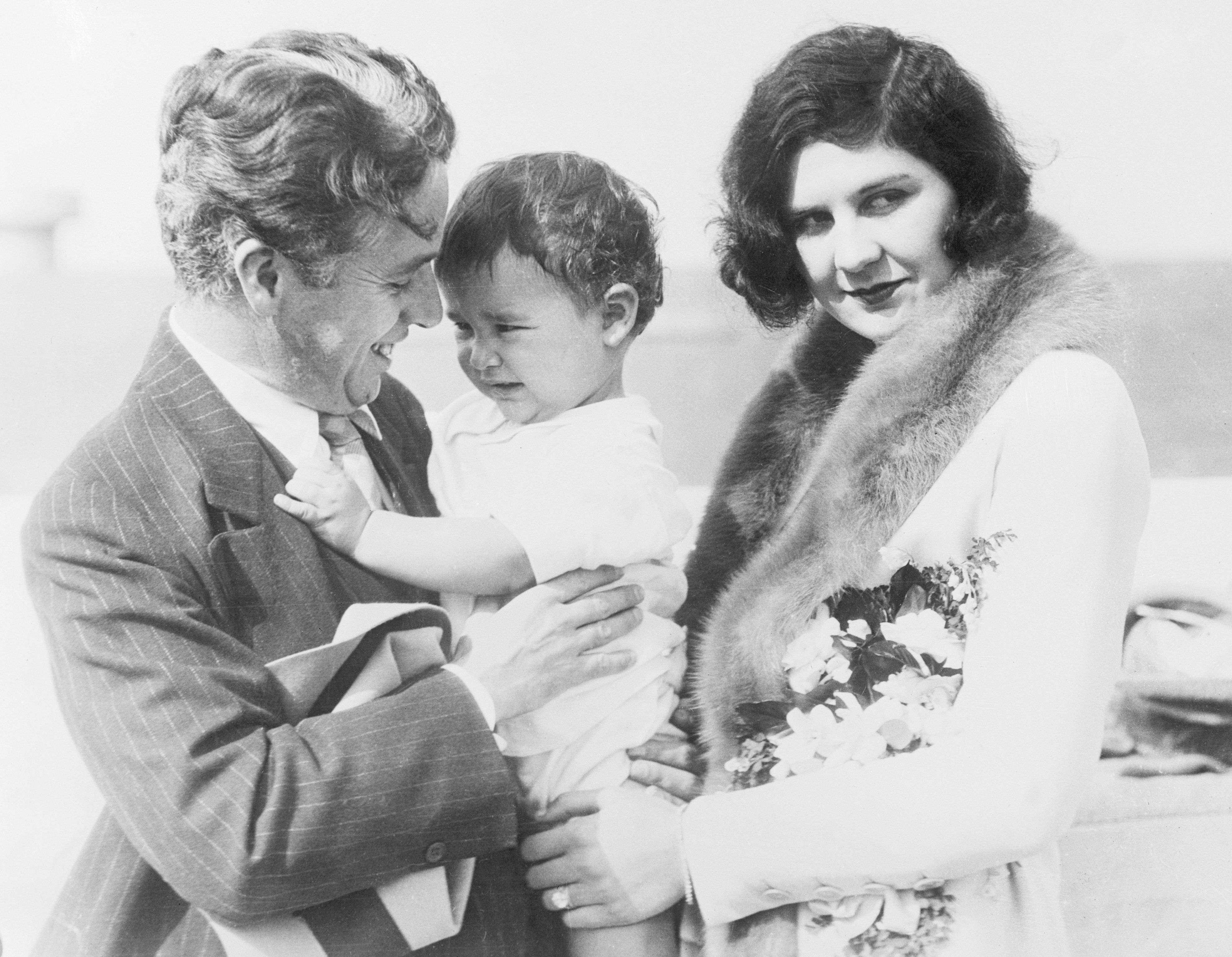 Charlie Chaplin, Lita Grey and their baby son, Charles Jr. on board the SS City of Los Angeles in November 1926  | Photo: GettyImages