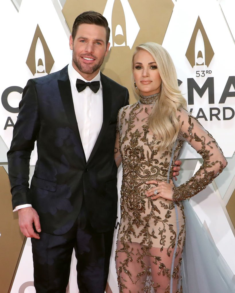Mike Fisher and Carrie Underwood arrive on the red carpet at the 53rd annual CMA Awards on November 13, 2019, in Nashville, Tennessee | Source: Taylor Hill/Getty Images