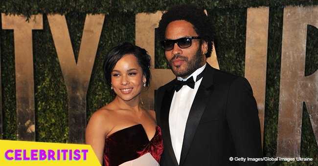 Lenny Kravitz carries his beautiful daughter Zoë in his arms in heartwarming picture