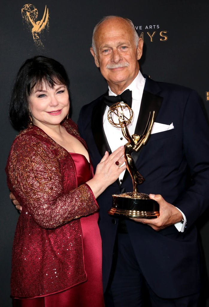 "Delta Burke, (L) and actor Gerald McRaney pose in the press room with the award for outstanding guest actor in a drama series for ""This is Us"" at the 2017 Creative Arts Emmy Awards 