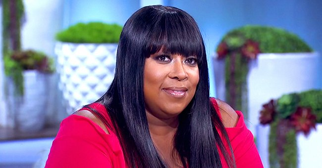 Loni Love Shows Her Curves after Impressive Weight Loss in an Olive Green Top & Tattered Jeans