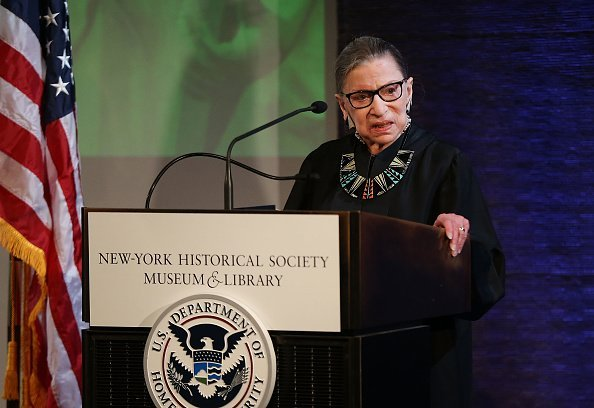 U.S. Supreme Court Justice Ruth Bader Ginsburg prepares to administer the Oath of Allegiance to candidates for U.S. citizenship | Photo: Getty Images