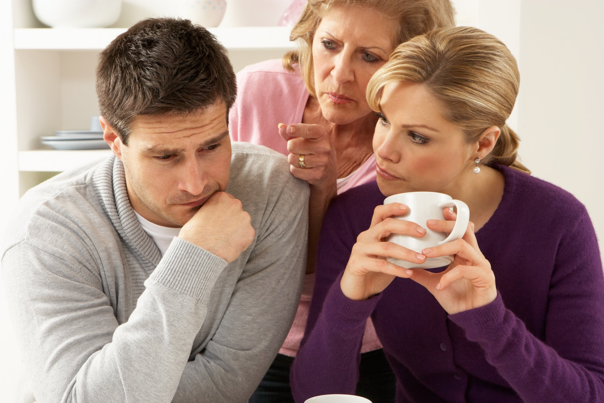 Older woman interferes in a couple's conversation | Photo: Getty Images