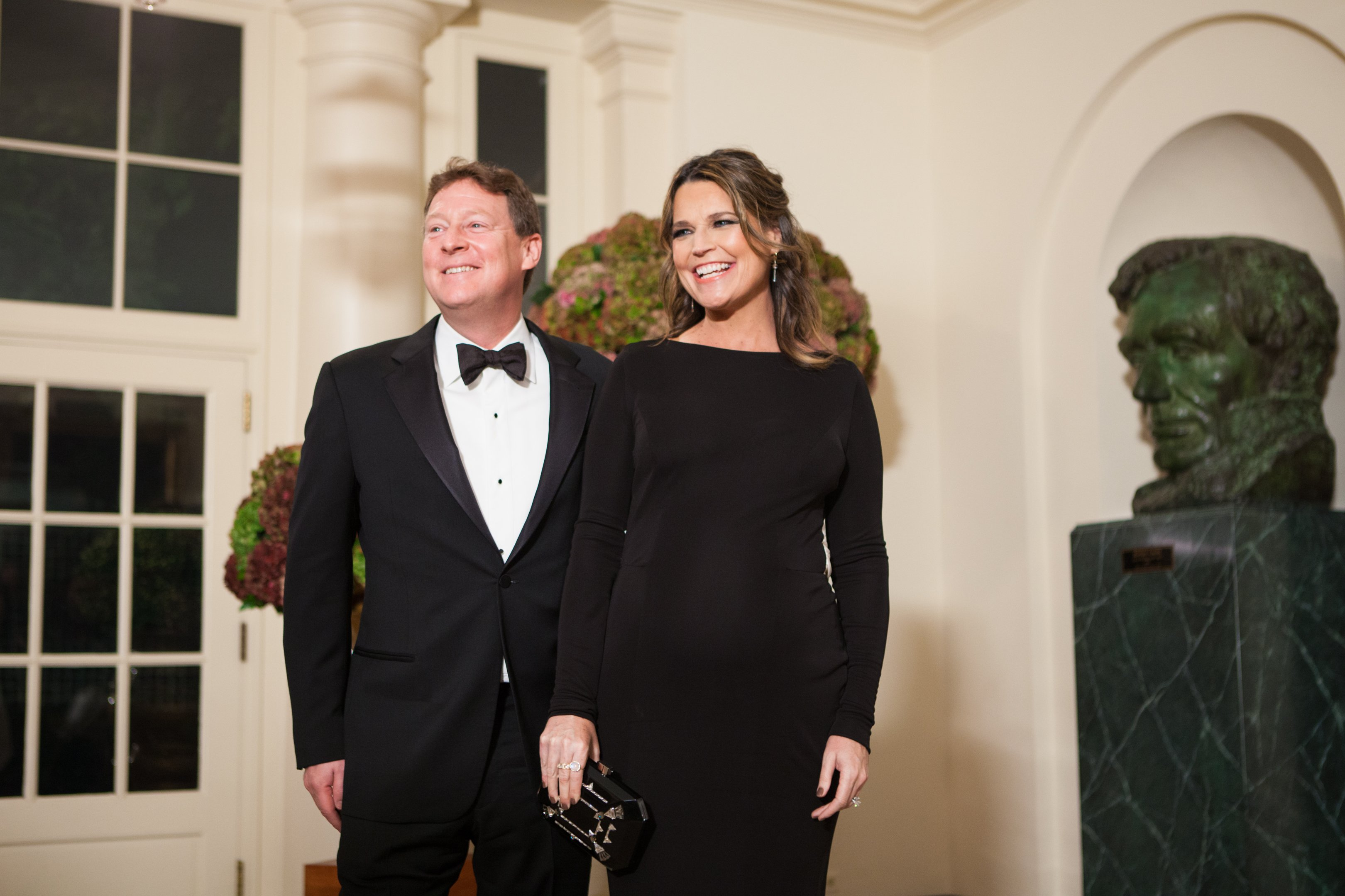 Savannah Guthrie and her husband Michael Feldman, arrive at the White House in Washington, DC, USA on 18 October 2016 | Photo: Getty Images