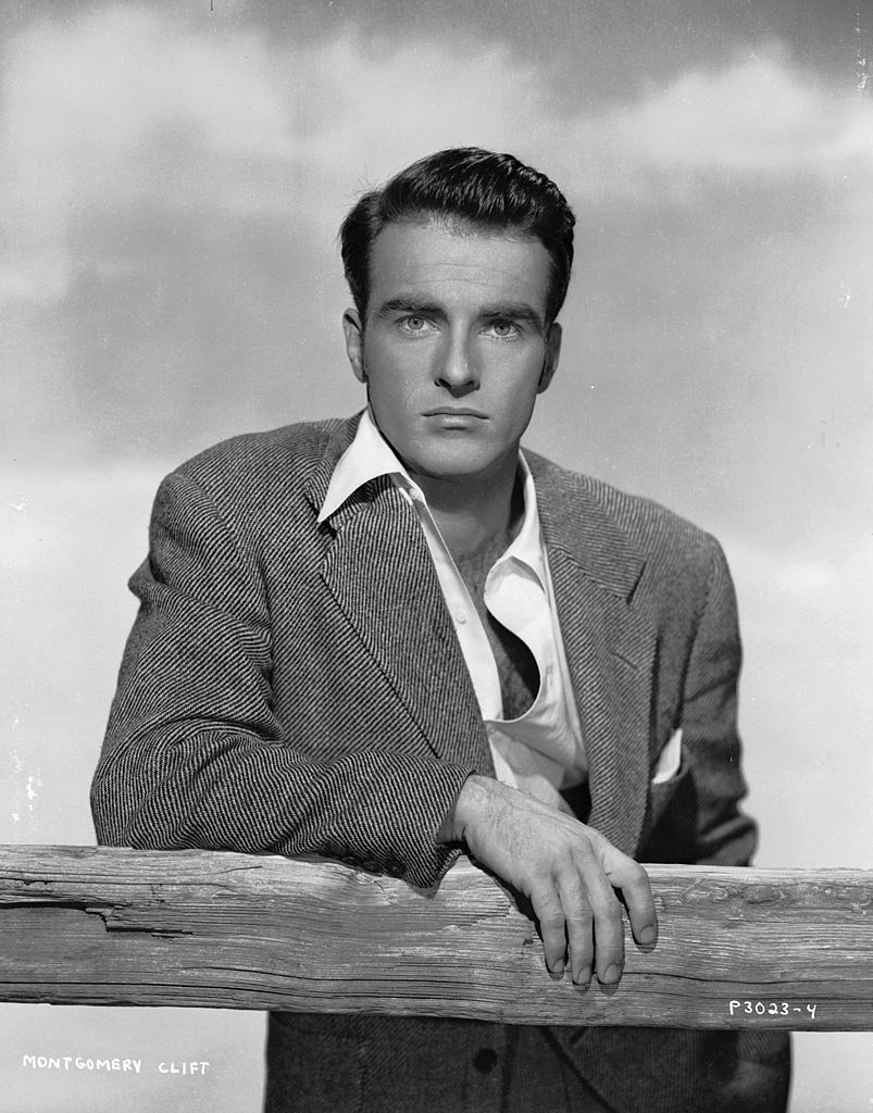 A portrait of Montgomery Clift leaning on a fence with an intent expression before his accident on 01 January, 1950   Photo: Getty Images