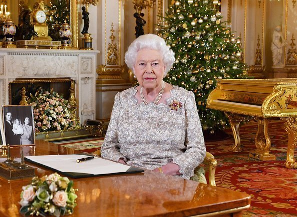 Queen Elizabeth II poses for a photo after she recorded her annual Christmas Day message, in the White Drawing Room at Buckingham Palace | Photo: Getty Images