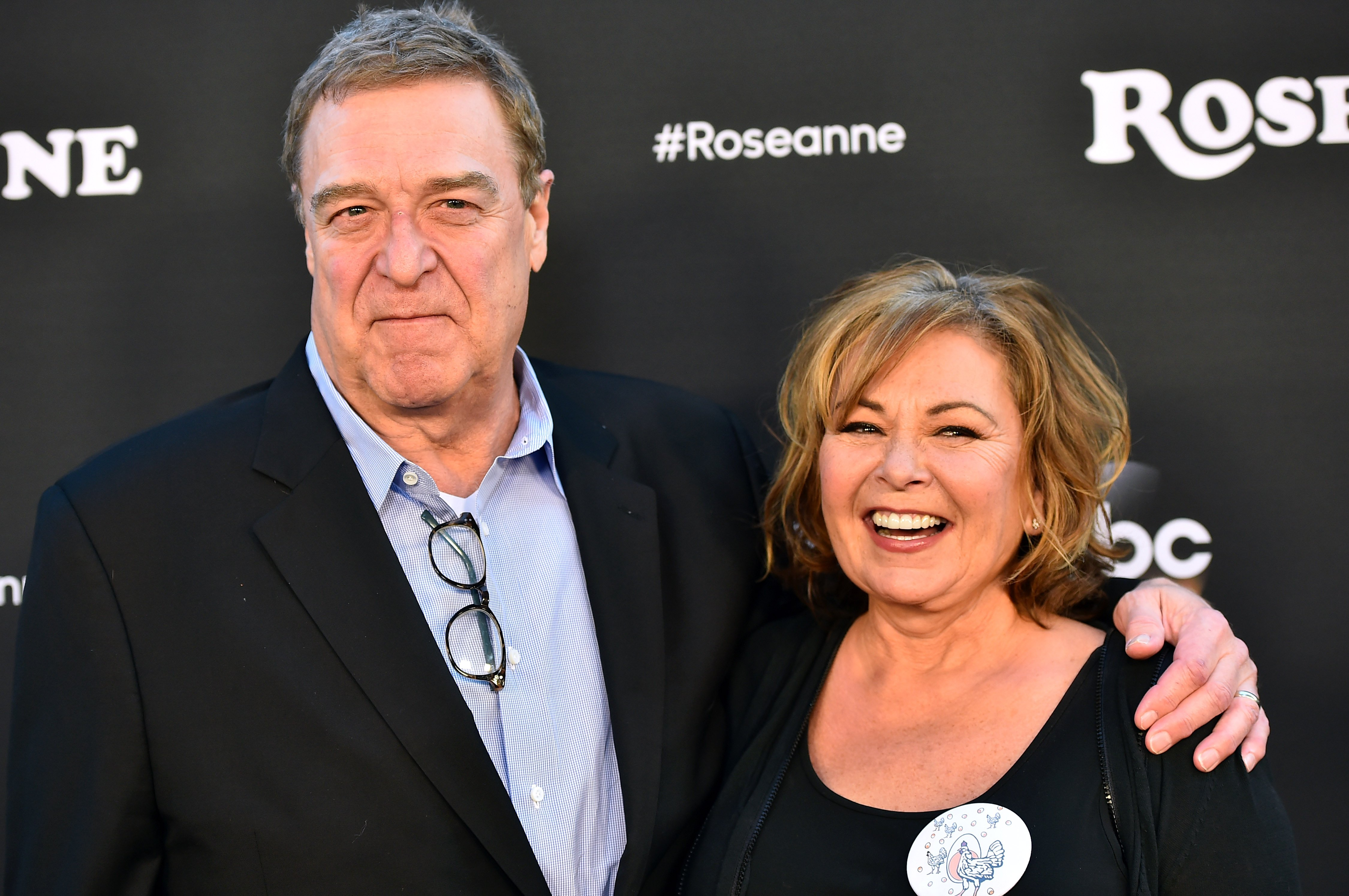 """Roseanna Barr and John Goodman attend the premiere of """"Roseanne"""" on March 23, 2018 