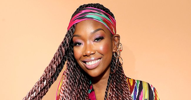 Watch Brandy Transform into Cinderella in a Blue Ball Gown and Crown in This Stunning Video