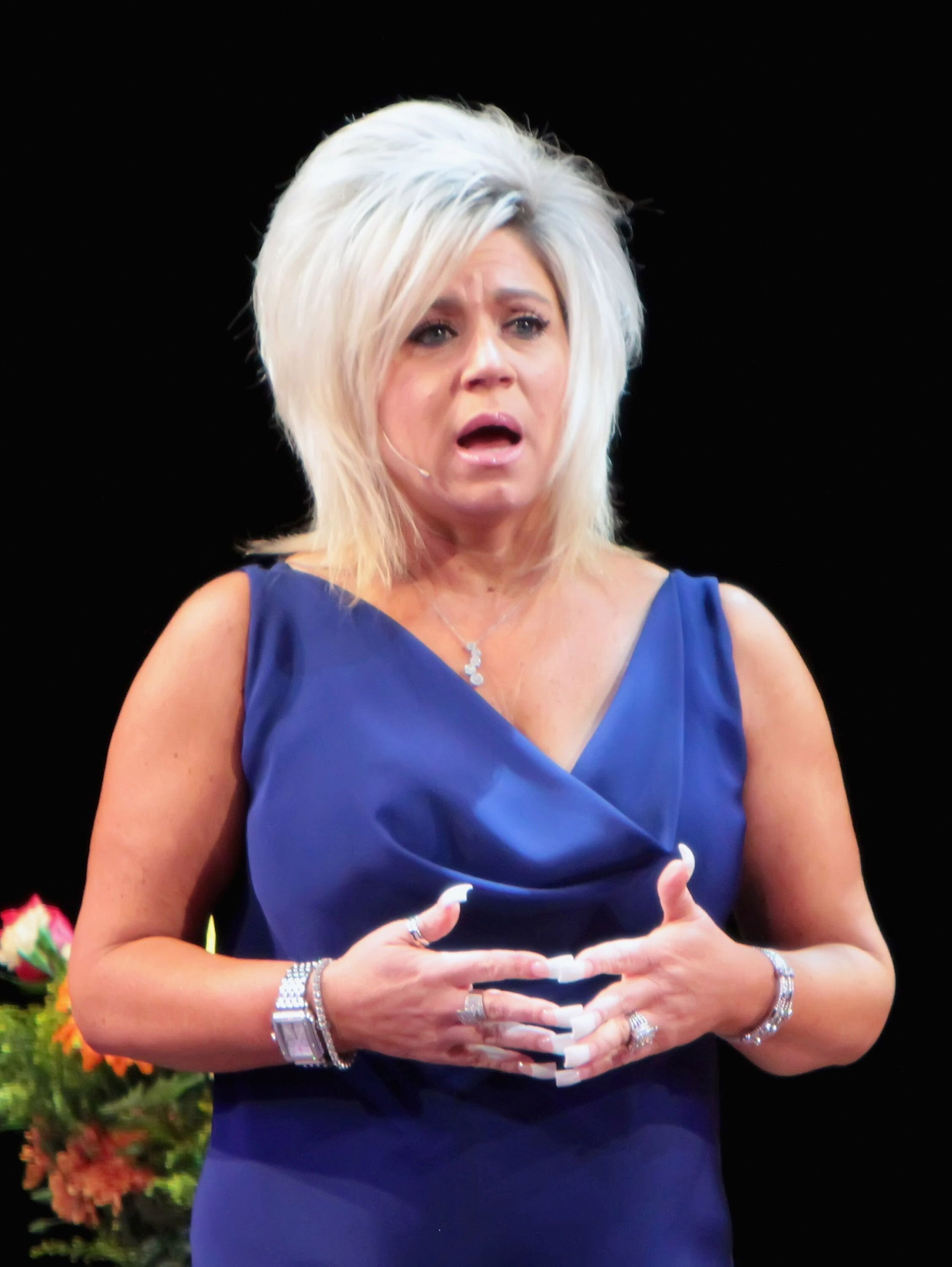 Theresa Caputo appears on stage at the Tropicana Showroom. | Source: Getty Images