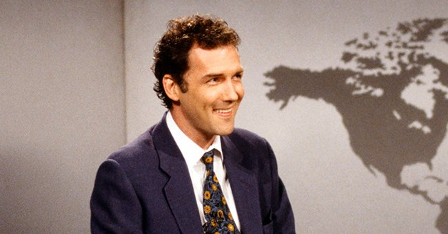 A portrait of Norm MacDonald smiling during anchoring duties | Photo: Getty Images