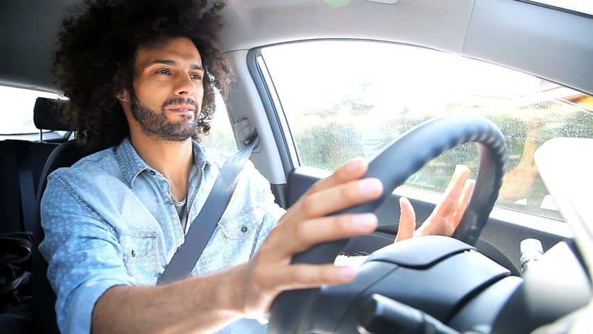 A young man driving a car | Photo: Shutterstock