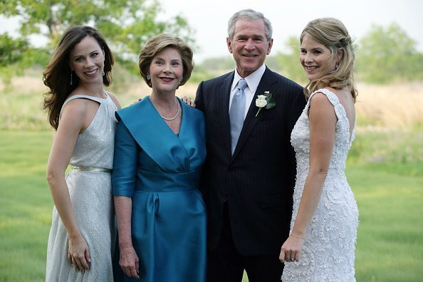 George W. Bush and Mrs. Laura Bush pose with daughters Jenna (R) and Barbara (L) prior to the wedding of Jenna and Henry Hager May 10, 2008 near Crawford, Texas | Photo: Getty Images
