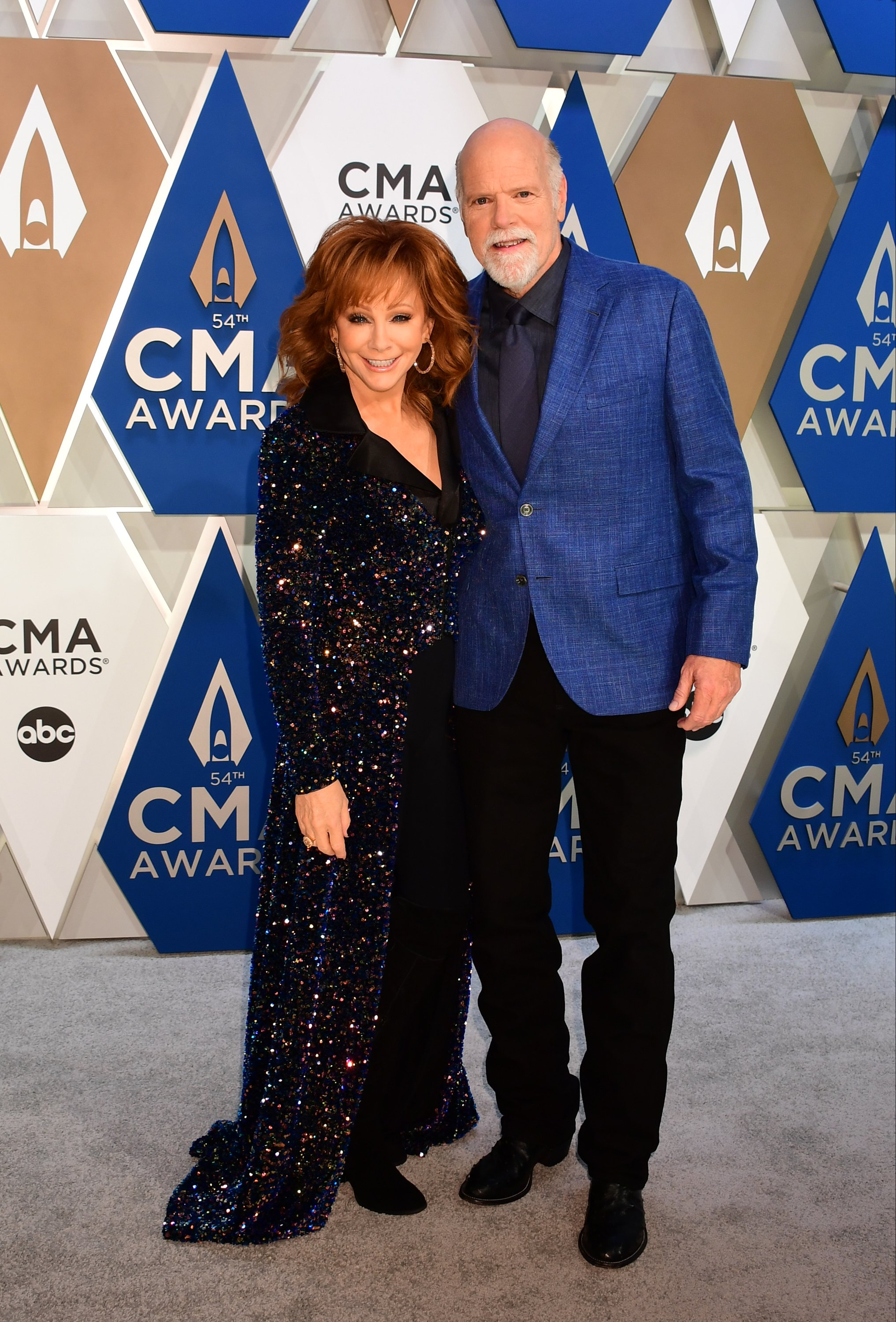 Reba McEntire and Rex Linn on the red carpet at the CMA Awards on November 11, 2020  | Photo: Getty Images.