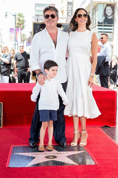 Simon Cowell, Lauren Silverman and Eric Cowell attend a ceremony honoring Cowell with a star on the Hollywood Walk of Fame on August 22, 2018, in Hollywood, California. | Source: Getty Images.