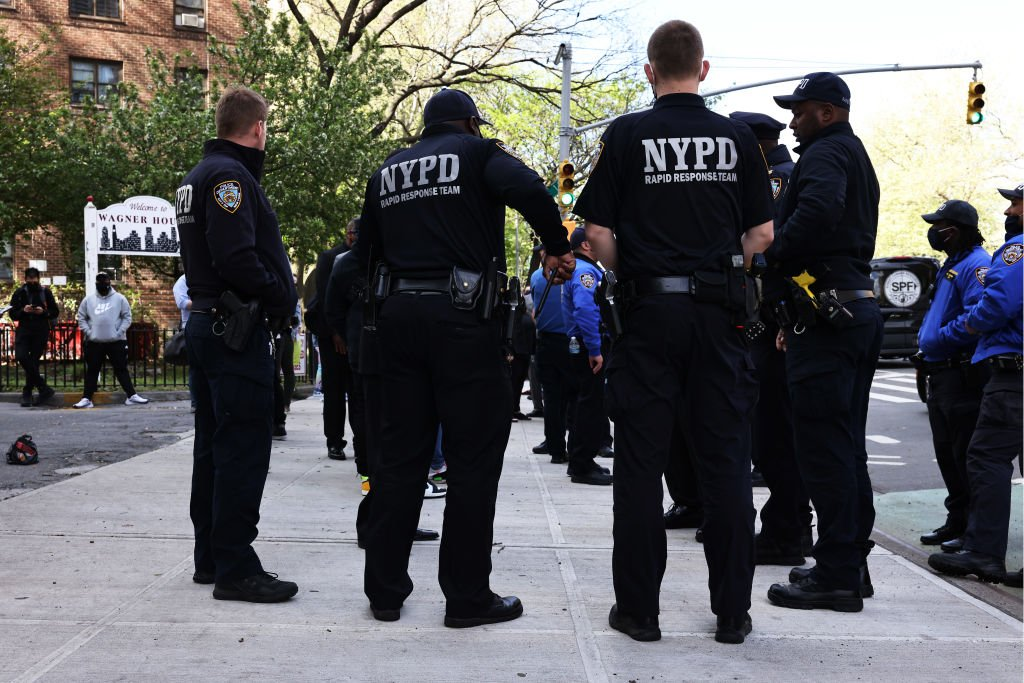 NYPD officers await the start of a peace walk to denounce the rise of gun violence in the city in the Harlem neighborhood on April 30, 2021   Photo: Getty Images