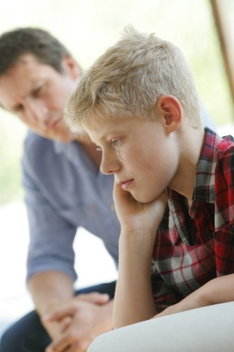 Photo of father talking to upset son   Photo: Getty Images