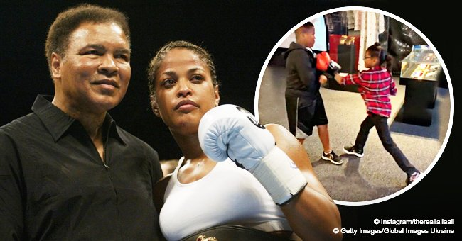 Muhammad Ali's daughter and grandchildren pay tribute to the late professional boxer at LA exhibit